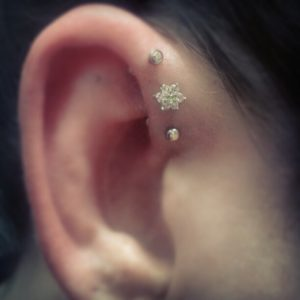 Triple Forward Helix Ear Piercing